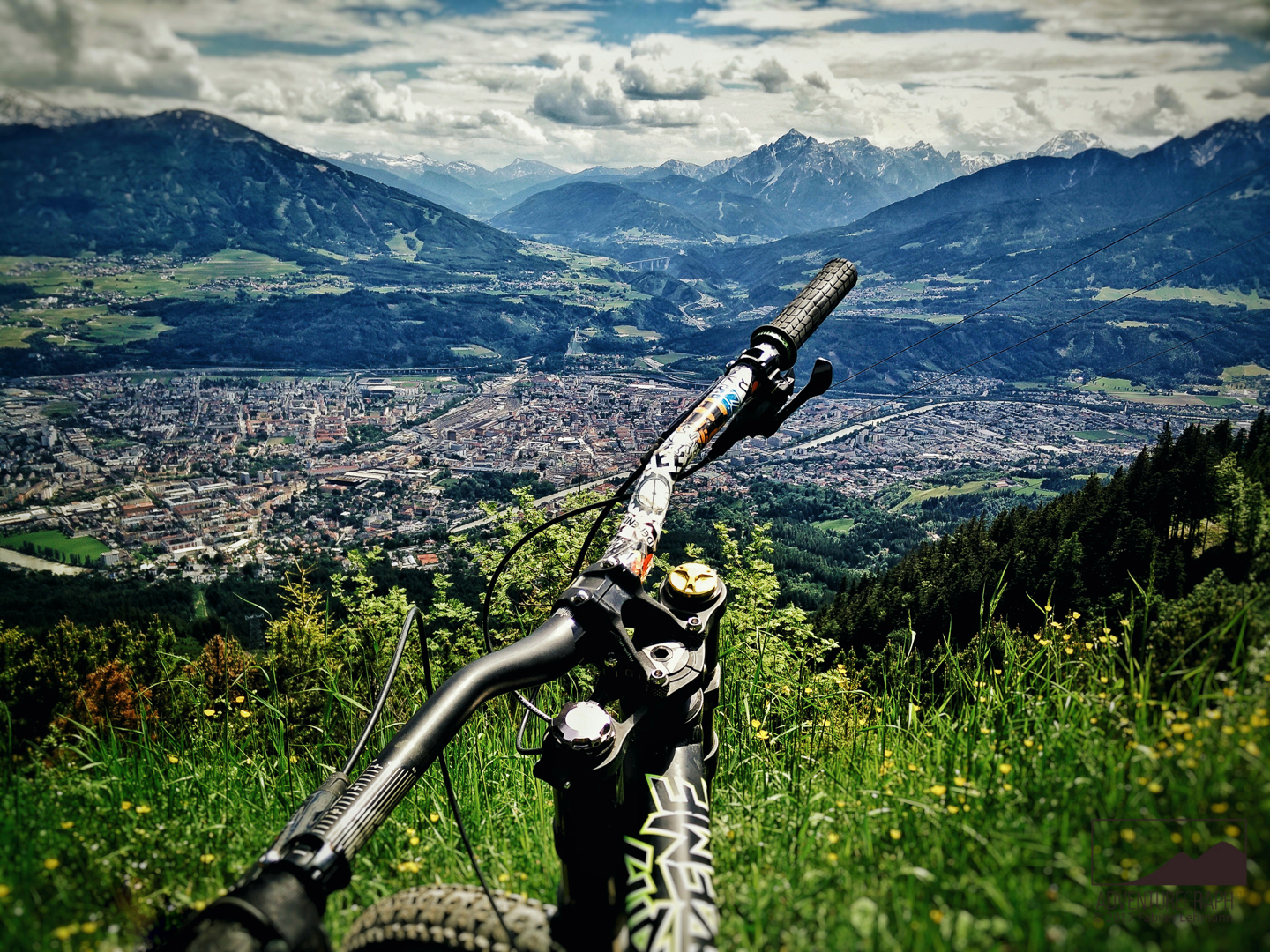 A landscape photo of Innsbruck's nature is visible from the downhill bikepark.