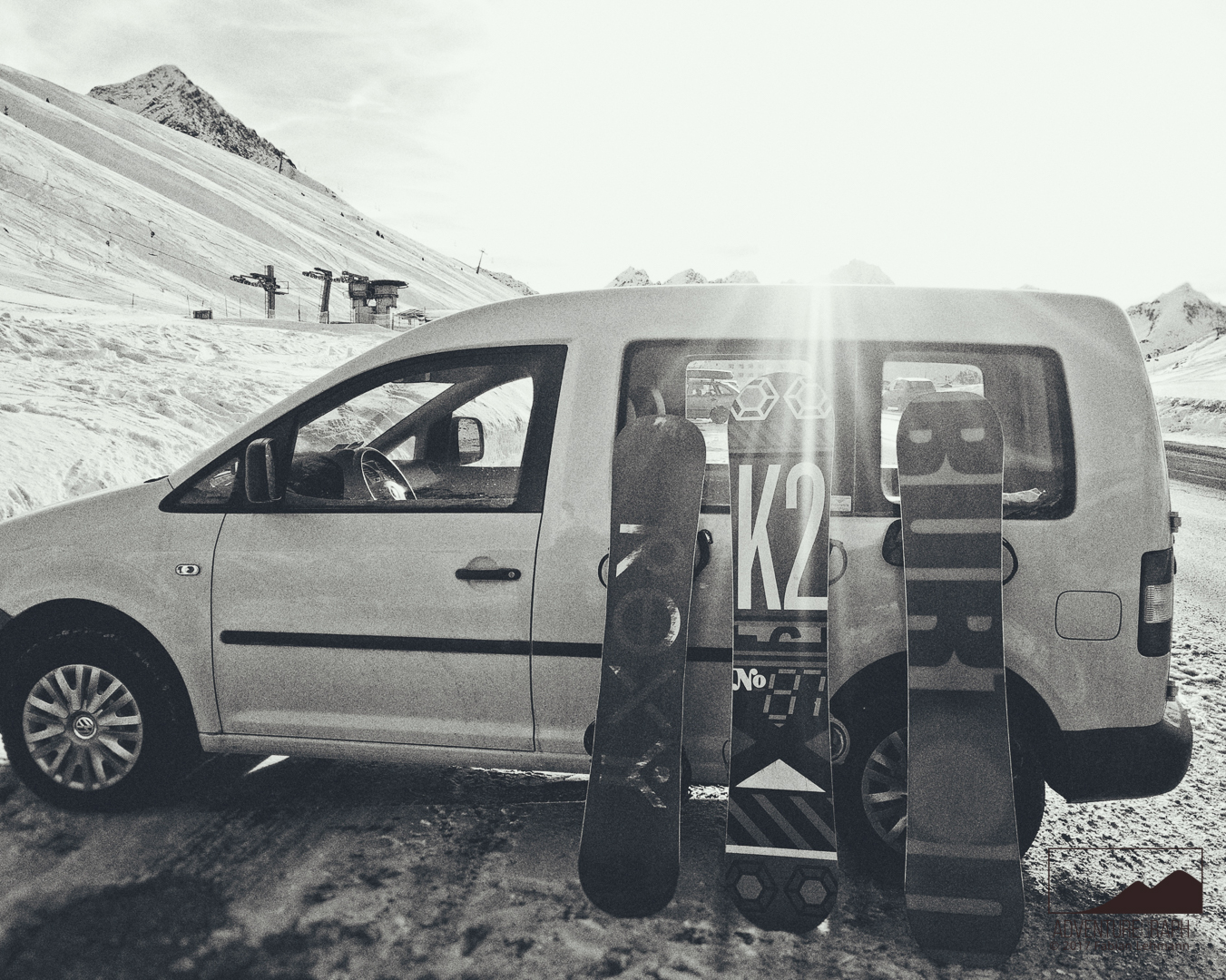 Traveling: A snowboard trip to a ski-resort with a car and friends.